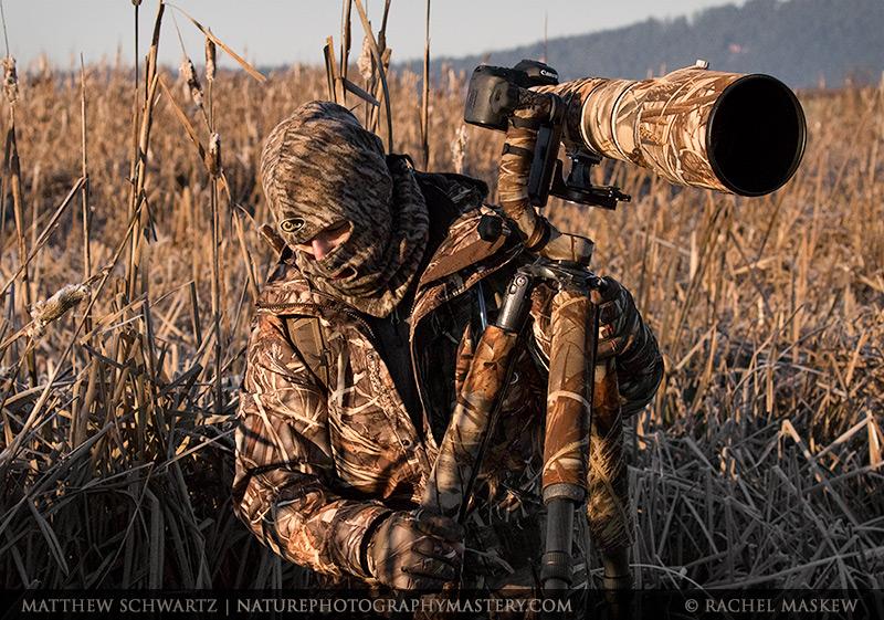 Matthew Schwartz in a marsh with full camo